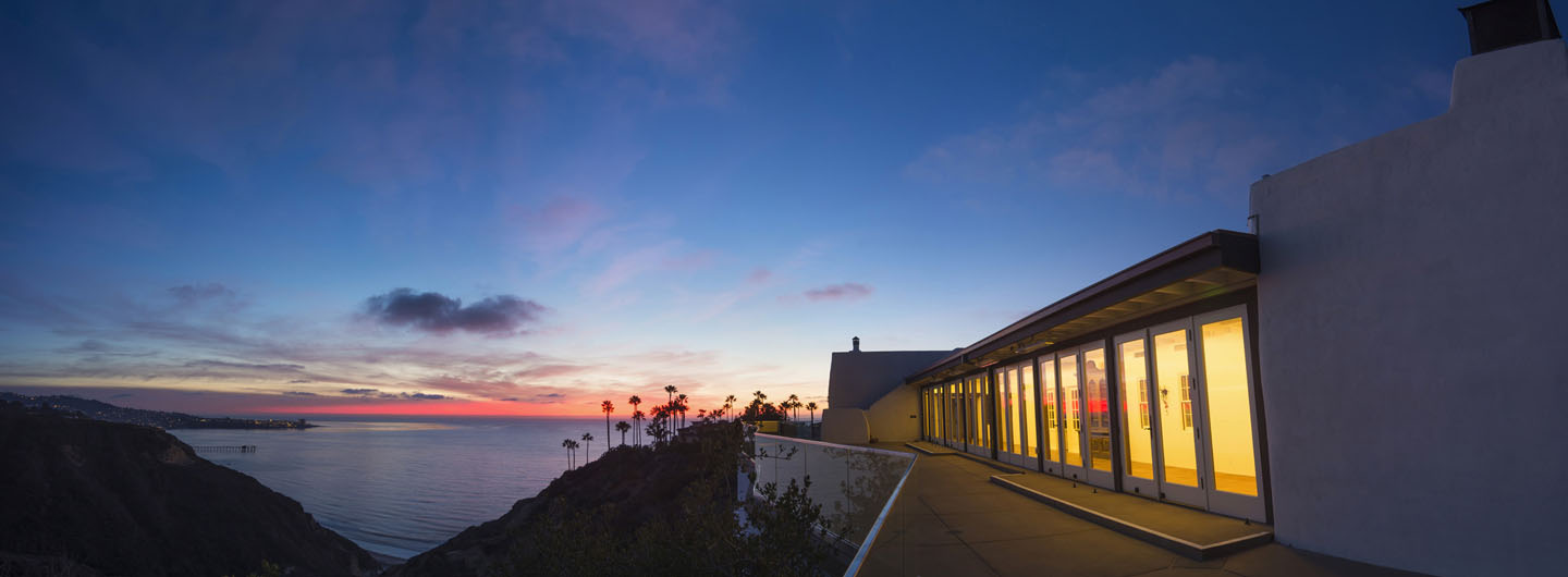 A building on UC San Diego's campus overlooking the ocean at sunset